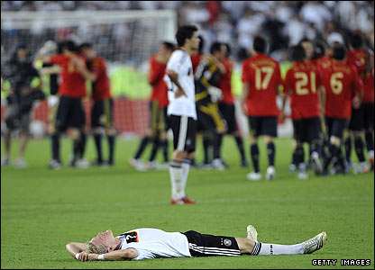 Schweinsteiger lies on the pitch following defeat