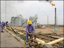 Workers on an Iraqi oil pipeline near Basra