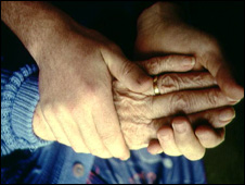 Carer and elderly person's hands
