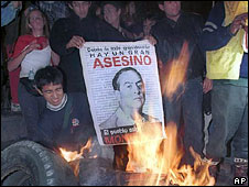 Peruvians burn a poster of Vladimiro Montesinos during a protest in Lima, 20 September, 2000