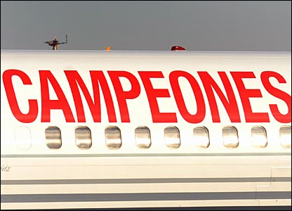 The plan carrying the Spanish side home has campeones (champions) emblazoned down the side