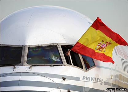 The pilot of the Spanish plane flies the traditional national flag from the cockpit window as he taxis into the stand