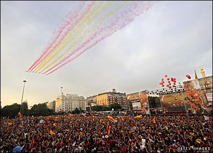 The Spanish air force salutes the team as they make a multi-coloured high-speed pass over the Plaza de Colon