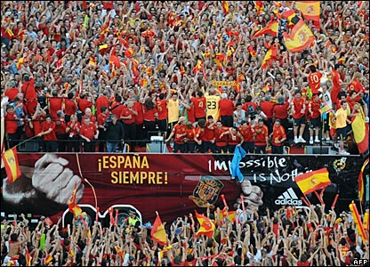 Spain inch their way through massive crowds in Madrid