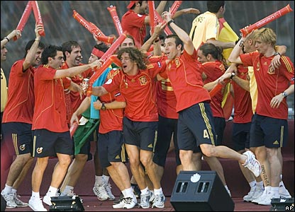 Spain's players celebrate after taking the stage in Madrid