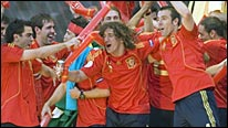 Spain's players join their fans in delirious celebrations as the fiesta looks set to last long into the night in Madrid