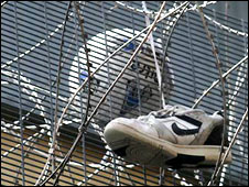 A training shoe stuck in razor wire at Colnbrook Removal Centre