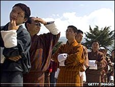 Bhutanese men queue to vote in March