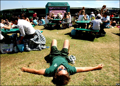 Wimbledon worker basks in the sun