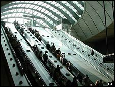 Commuters on an escalator in Canary Wharf