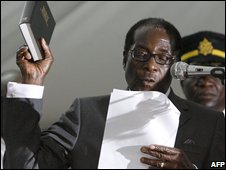 Robert Mugabe is hastily sworn in for a sixth term in office in Harare