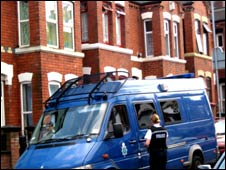 Police van at an address being searched by officers