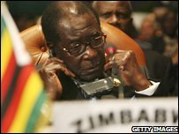 Zimbabwean President Robert Mugabe attends the opening of the 11th African Union Summit