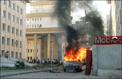 A van is set on fire by protesters in Ulan Bator on 1 July 2008