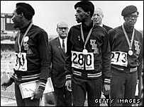 400m medallists, (l-r) Lee Evans (gold), Larry James (silver), and Ron Freeman (bronze), wore berets to sympathise with Smith and Carlos after they were thrown out of the Olympics