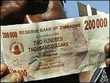 Man holds Zimbabwean banknote
