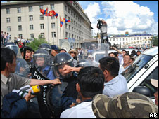 Protesters clash with police during post-election demonstrations in Ulan Bator, Mongolia on Tuesday