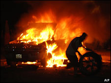 A car is set ablaze during post-election protests in Ulan Bator, Mongolia on Tuesday