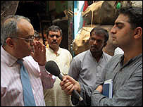 Mukul Devichand interviewing in Dharavi, Mumbai