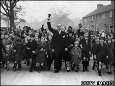 Teacher rounds up children on an LCC estate at Mottingham for Sunday school class in 1937