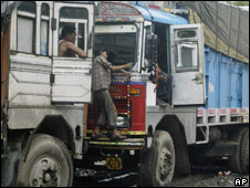 A worker cleans a truck in Allahabad, India, on 2 July 2008