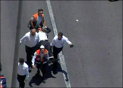Injured ultra-Orthodox man being taken away on a stretcher