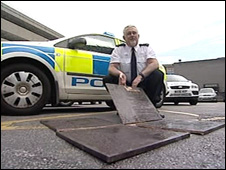 Plaque in four pieces with police officer