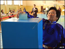 A woman casts her vote in Ulan Bator, in general elections in Mongolia on Sunday