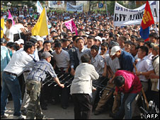 Protesters prepare to attack the ruling party headquarters in Ulan Bator, Mongolia, on Tuesday