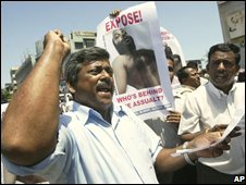 Sri Lankan journalists shout slogans as they hold a poster of their colleague Namal Perera during a protest in Colombo, Sri Lanka, Wednesday, July 2, 2008