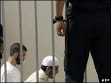 Suspected terrorists arrive for their 2007 trial at an anti-terrorist courthouse in Sale