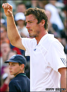 Marat Safin celebrates beating Feliciano Lopez