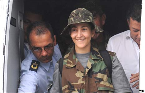 Ingrid Betancourt steps to freedom at an air base in Bogota on 2 July 2008