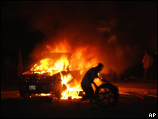 A man burns a car on 1 July 2008