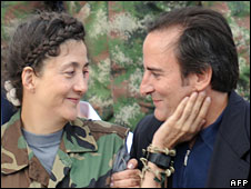 Ingrid Betancourt (left) smiles at her husband Juan Carlos Lecompte upon her arrival at the Catam air base, Bogota, 2 July 2008