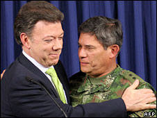 Colombian Defence Minister Juan Manuel Santos (L) hugs Colombian Army Commander-in-chief general Freddy Padilla, Bogota, 2 July