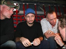 Keith Stansell, left, Marc Gonsalves, centre, and Thomas Howes in an unknown location after being released