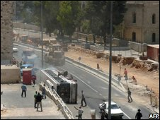 Hussam Dwayat drives bulldozer south along Jaffa Street