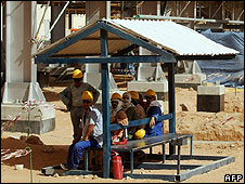 Workers at the Khurais oil field