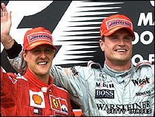 David Coulthard celebrates beating Michael Schumacher in the 2001 Brazilian Grand Prix