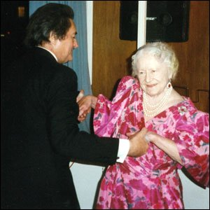 A photograph of William Tallon dancing with the Queen