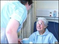 Feeding the elderly. Photo caption:John Cole/SPL