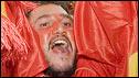 A Spain fan celebrates victory