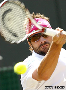 Arnaud Clement in action against Rainer Schuettler