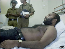 Journalist Namal Perera lies on a hospital bed in Colombo. Photo: 30 June 2008