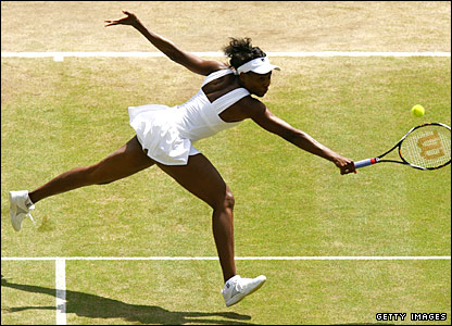 Venus Williams stretches for a backhand against Elena Dementieva