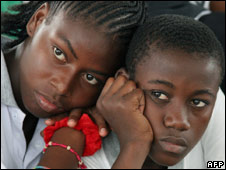 Two youngsters celebrating a donation made by an NGO to people displaced by violence at Pedro Grau school in Quibdo, department of Choco, in April 2008