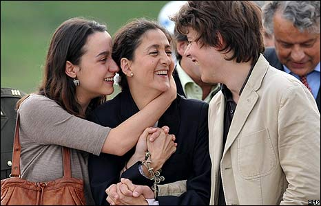 Ingrid Betancourt (C) is reunited with her children Melanie (L) and Lorenzo Delloye in Bogota
