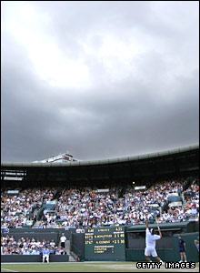 Dark rainclouds gather above Court One