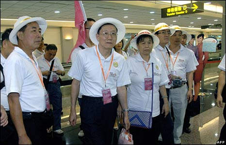 A group of Chinese tourists wait for their bags in Taoyuan airport in Taiwan